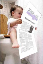 Photo: Baby reading Family Ties® Newsletter